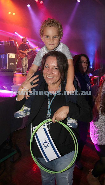 Communal Yom Haatzmaut Celebration at Moriah College. Inbar Yudasin dances with her son Noam during the concert.