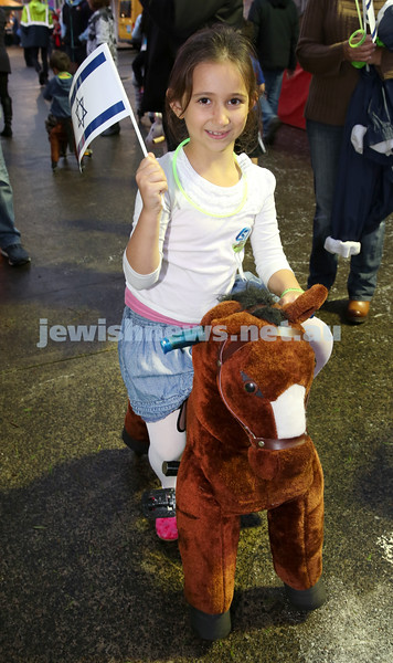 Communal Yom Haatzmaut Celebration at Moriah College. Temima Suttner rides a toy pony.