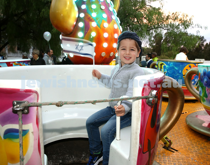 Communal Yom Haatzmaut Celebration at Moriah College. Zac Garson on the Tea Cup ride.