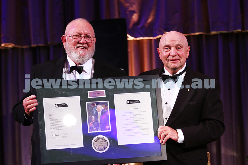 21-11-13. Tom York (right) receives his Basketball Australia Hall of Fame induction plaque from Ken Madsen, Chairman of the Honours and Awards Commission. Photo: Peter Haskin