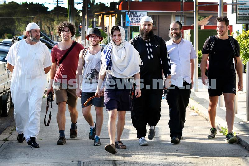Yitzi Tuvel (centre) walking through Lakemba after leaving from Bondi. Supported by friends from both the Jewish and Moslem communities. L-R Mazen Zraika, Yehuda Aharon, Nathan Simmon, Yitzi Tuvel, Ayman Abufarha, Rabbi Zalman Kastel, Yanky Klein.