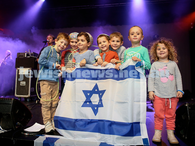 Communal Yom Haatzmaut Celebration at Moriah College. A group of children on stage  with an Israeli flag.