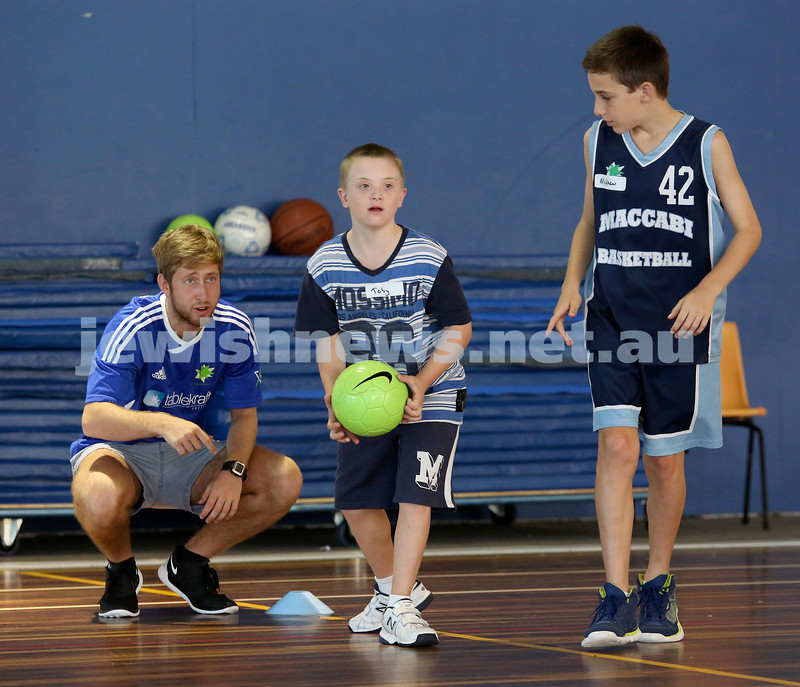 Children from the Friendship Circle enjoy a sports day with companions and Maccabi junior basketball players. Toby about to throw a ball as his companion Matthew Bozic (R) looks on along with Jared Engelman (R)