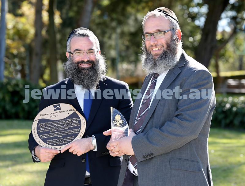 Rabbi Dovid Slavin and Rabbi Mendel Kastel with their awards from Waverley Council.