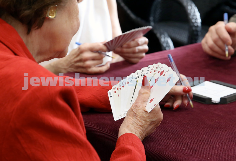 Bridge at COA. Lori Winston holds her cards.