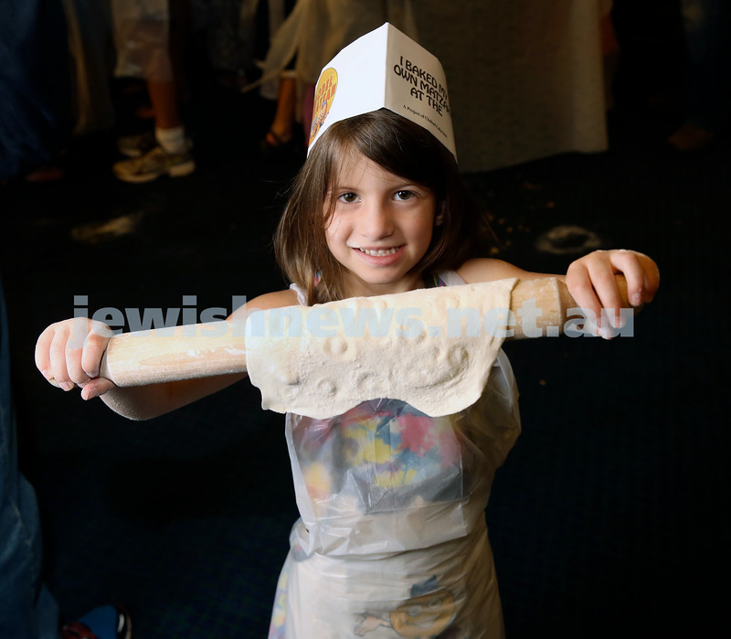 Model Matzah Bakery at Chabad Of The North Shore. Children made their ownd dough and baked their own Matzah. Leora Levy carrying her matzah to the oven.
