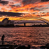 View of Sydney Opera House and Sydney Harbour Bridge at sunset.