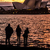 View of Sydney Opera House at sunset.
