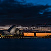 View of Sydney Opera House and Sydney Harbour Bridge at dusk.