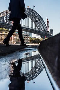 Reflection view of Sydney Harbour Bridge from the Overseas Passenger Terminal at Circular Quay.