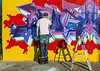 101212 - 5322 Graffiti Artist At Work With Makeshift Tools