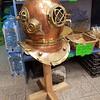 Old diving helmet in the sponge store.