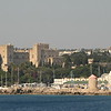 Mandraki harbor with Rhodes Old Town Castle.