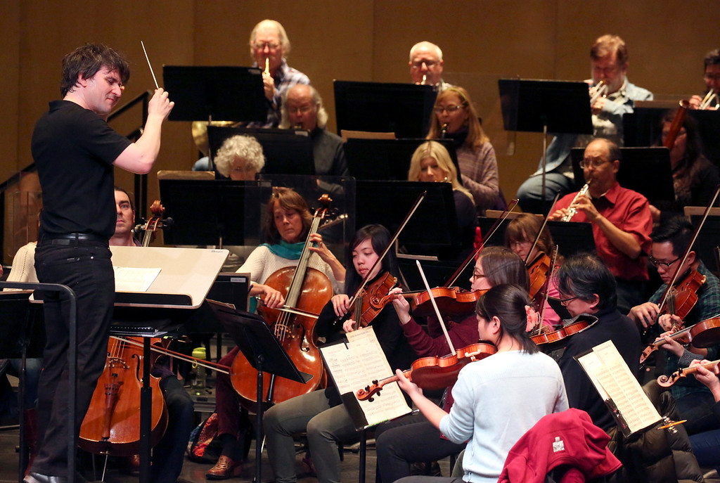 . Maestro Daniel Stewart conducts the Santa Cruz Symphony this week in preparation for the symphony\'s 60th anniversary season, which begins Friday (Shmuel Thaler -- Santa Cruz Sentinel)