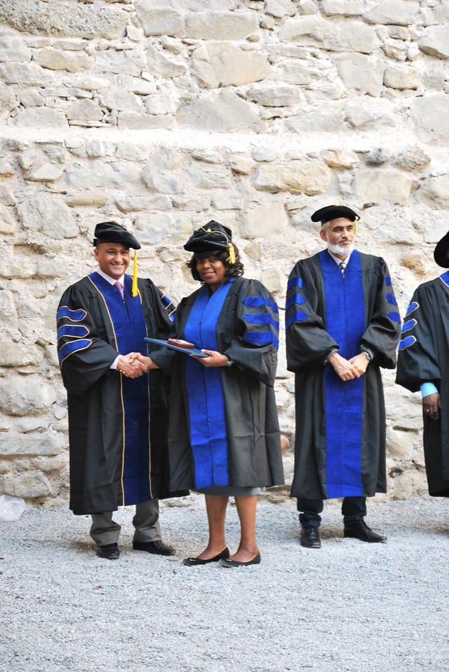 Dr. Liane Moosho Imakando is congratulated by Dr. Hasan Al Fardan.