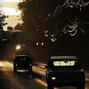 A truck with one headlight out shining travels down East Genesee Street at dusk.  Photo by: Vernon Young Jr.
