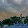 Hall of Languages rainbows during stormy sunset