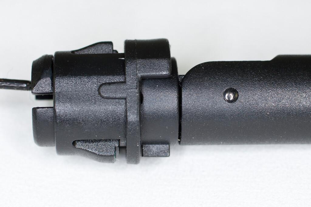 Bezel inserts into panel with castellation external. Antenna installs from castellation side.  Small key on antenna allows 180-deg rotation in bezel