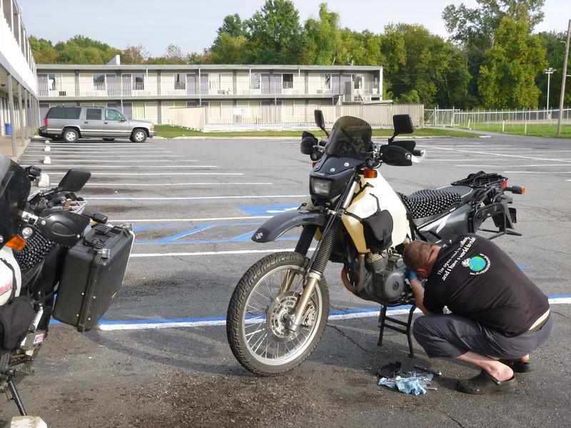 Bike work in the parking lot, Regal Inn, North Little Rock, AR