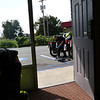 View of Adam doing bike work in the parking lot, Regal Inn, North Little Rock, AR