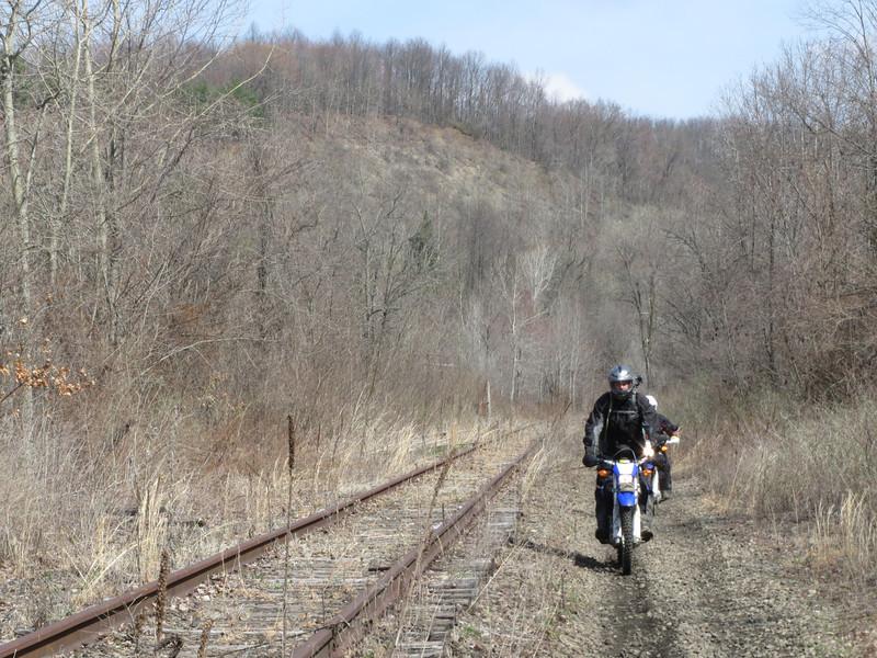 Alan along the unused RJ Corman RR tracks, Uhrichsville.  Jon just behind him.