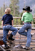 Two buckaroos wait their turn to rope some steers.