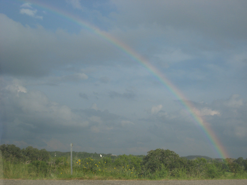 Rainbow on the drive...this was probably 30 minutes from Port Aransas.    It stretched all the way across, but I couldn't fit all of it into frame.