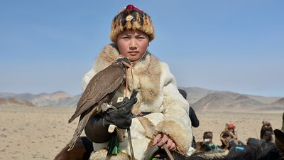 Young Kazakh Eagle Hunter with his falcon