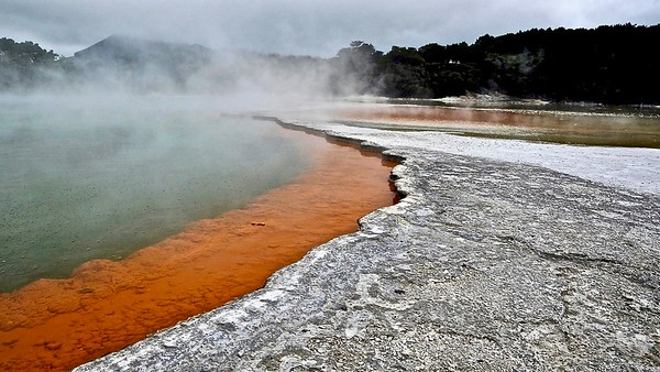 Champagne pool ( geothermal ) -The orange colour originates from deposits of arsenic and antimony sulfides.
