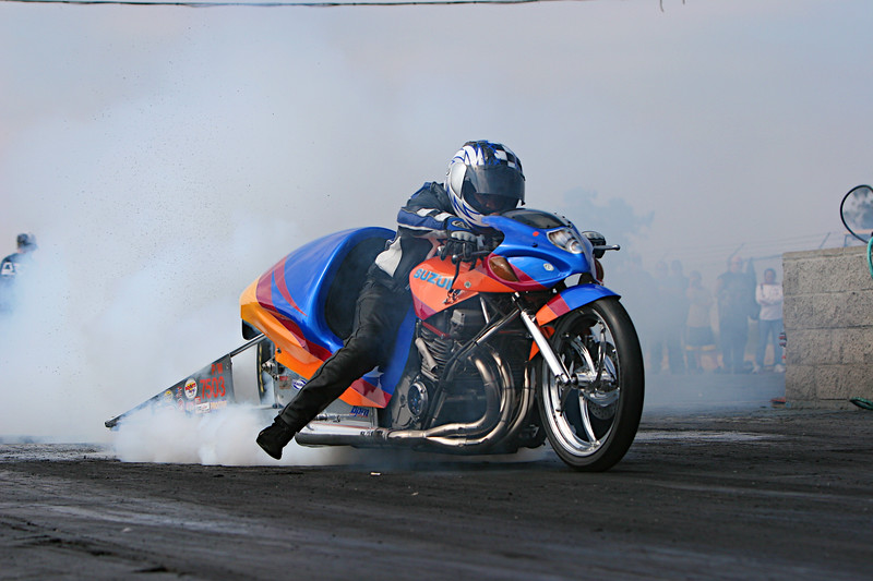 "Darryl Meadows/<p><a href=""http://www.WatsonPerformanceProducts.com/""target=""_new""> Watson Performance Products</a></p> Lites up his tire, #2/9"