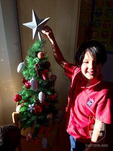 Grade 1 students decorate their room.
