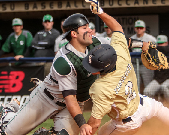 Close at Home<br /> John Faircloth (2, CSU) slides home, narrowly missing the tag of Thor Meeks (55, Marshall), to help lead the Bucs to a 6-4 victory over the Thundering Herd. February 25th, 2012