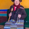 Pilgrim woman holding prayer wheel and prayer beads- Jokhang Temple, Lhasa