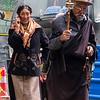 Pilgrims walking around outside of Jokhang Temple - Lhasa