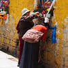 Praying at a shrine - Jokhang Temple, Lhasa