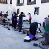 Buddhist pilgrims praying outside Jokhang Temple - Lhasa