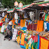Vendors selling Buddhist religious items - Jokhang Temple, Lhasa