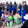 Vendors selling cans of yak butter - Jokhang Temple, Lhasa