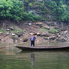 Man in small boat on a tributary of the Yangtze- Three Gorges, Yangtze River