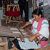 Weaving on a traditional loom.