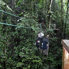 Crossing a deep ravine on a zip line.