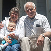 On the front stoop with Grandma and Grandpa