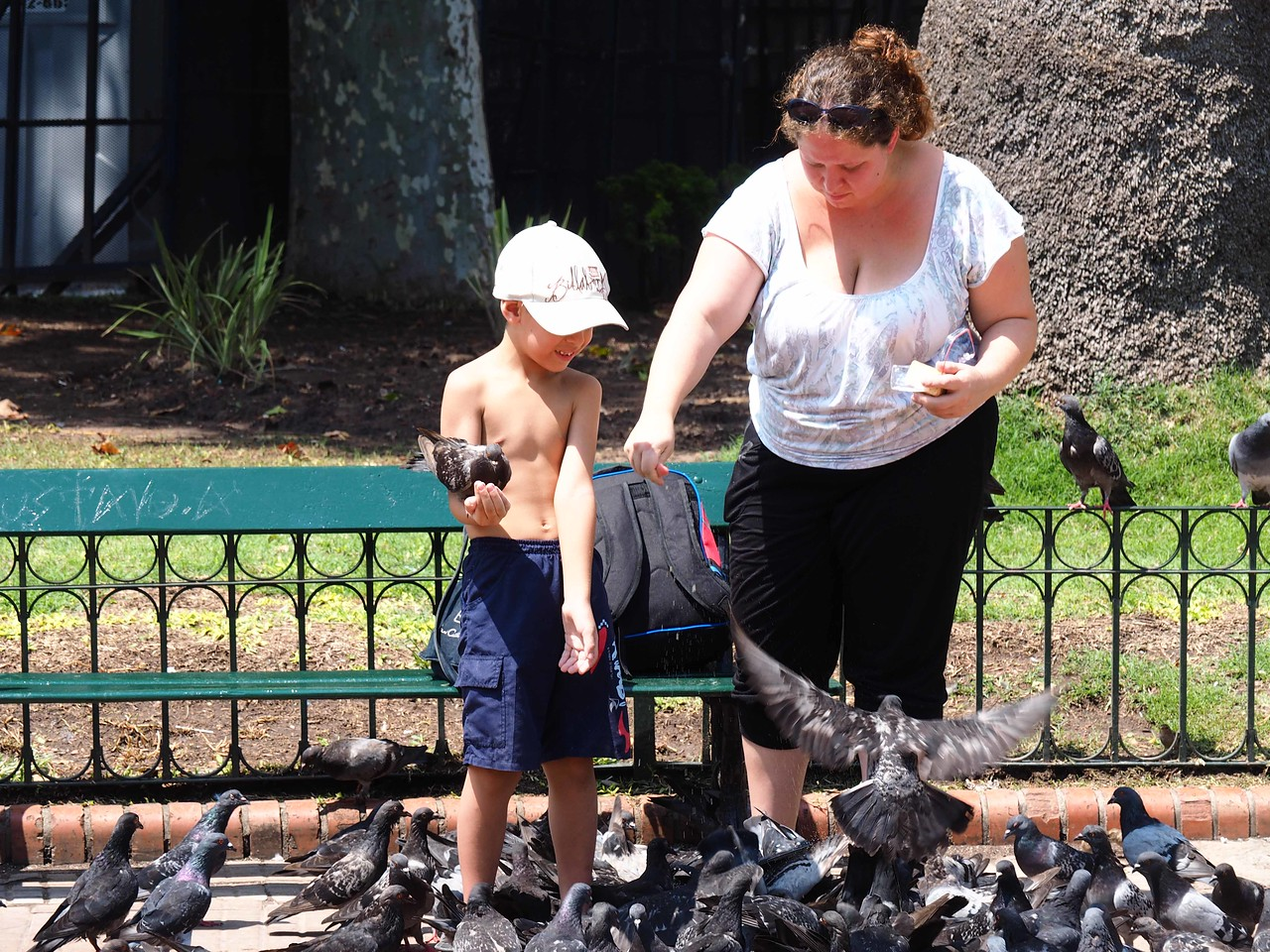 Boy and Mother Feeding Pigeons