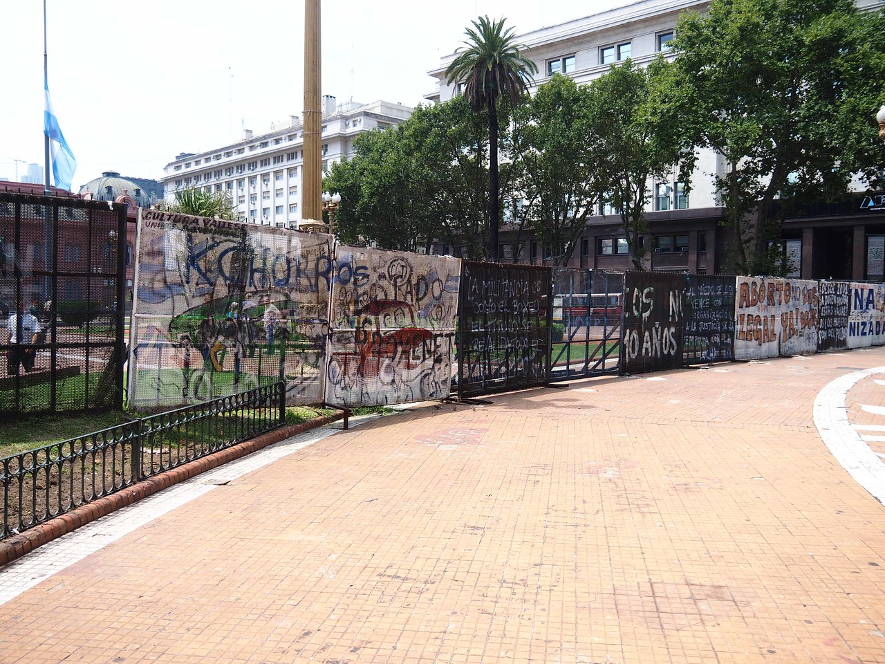 Protest Signs on Security Fence in Front of Presidential Palace