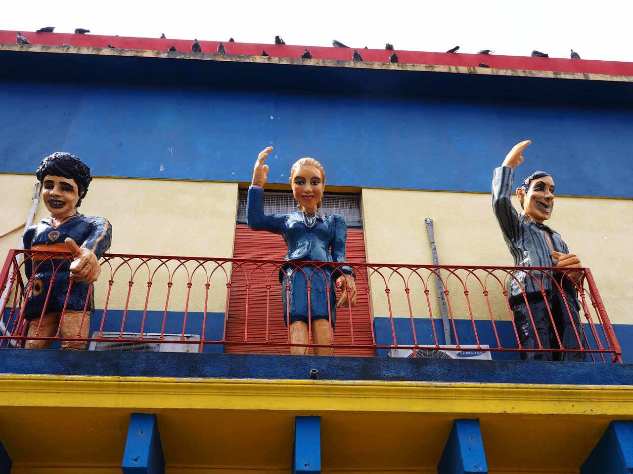 Statues Above a Store in La Boca