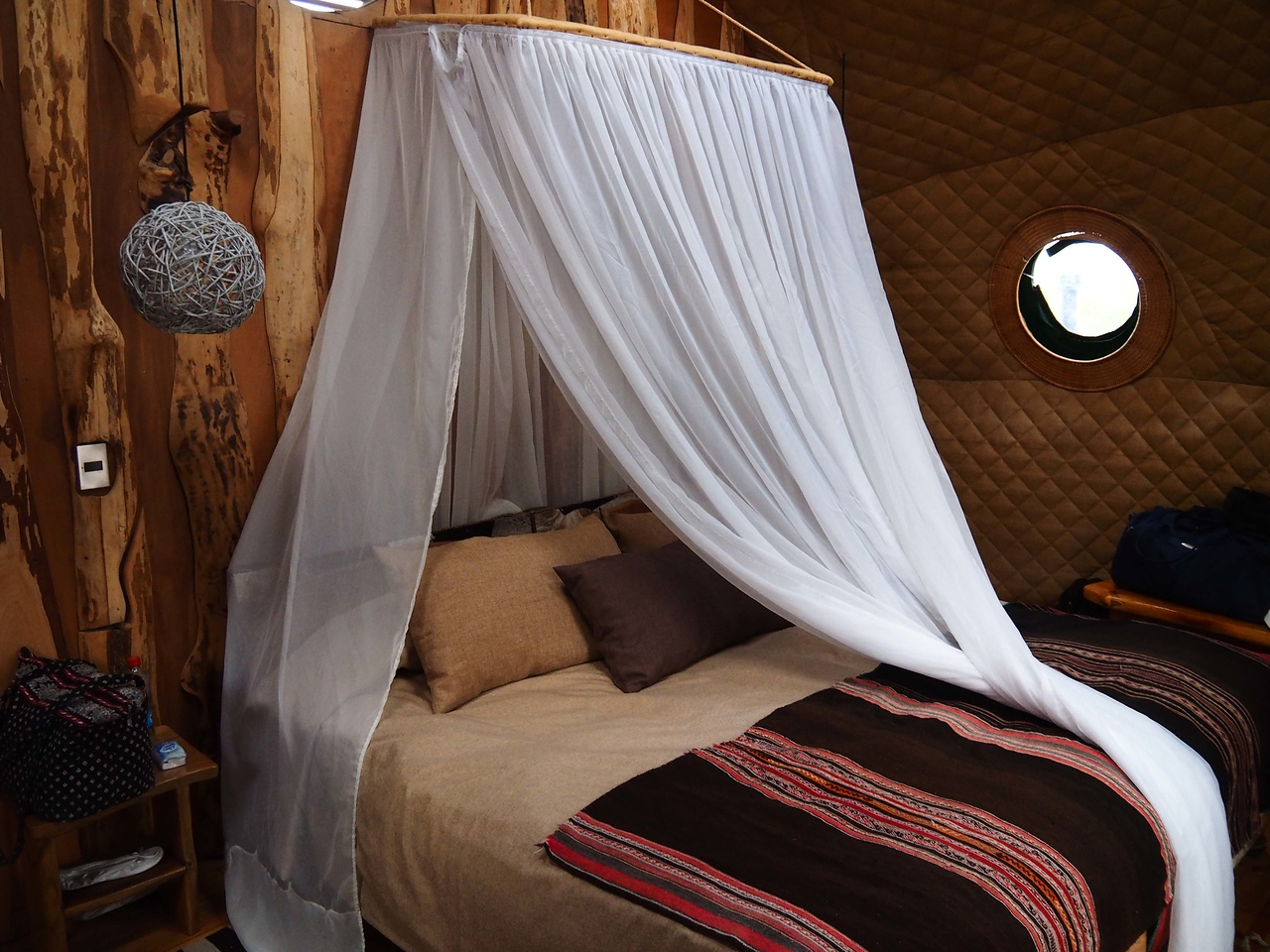 Bed with mosquito netting