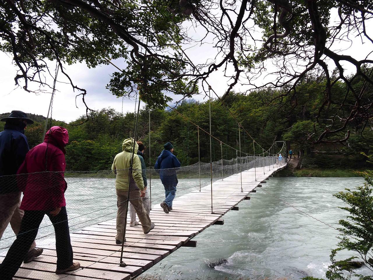 Across the Grey River on a swinging bridge in 50 mph winds
