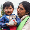 Young woman (cell phone vendor) and child, Izuchaca