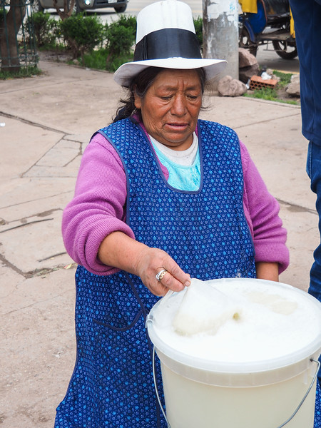 Selling Chicha on a street corner, Izcuchaca