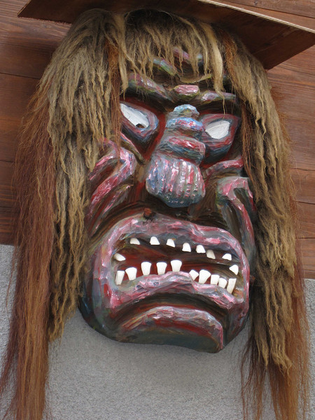 Wooden mask hung on outside of homes in Blatten and used to ward of bad spirits (no fooling).